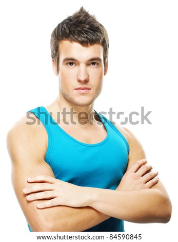 Portrait of young dark-haired serious man wearing blue t-shirt against white background. - stock photo