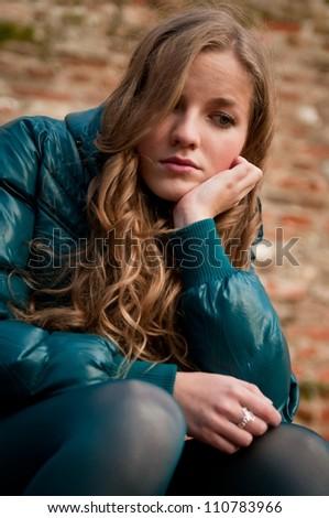 Portrait of young depressed woman outdoors -  autumn season - stock photo