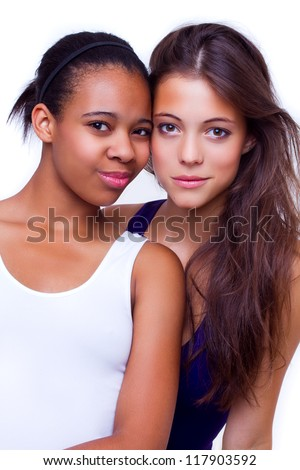 portrait of young different nationalities teenage girlfriends, caucasian woman and african american woman - isolated on white background - stock photo