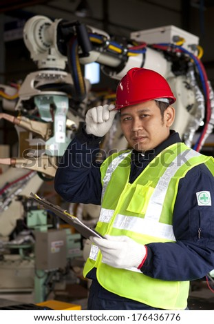 Portrait of young engineer in red hat