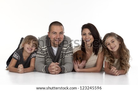 Portrait of young family on white background.