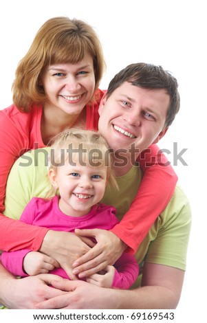 Portrait of Young family with their little daughter looking at camera - stock photo