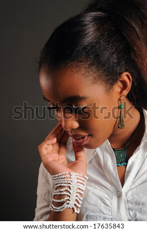 Portrait of young fashion african girl thinking - stock photo