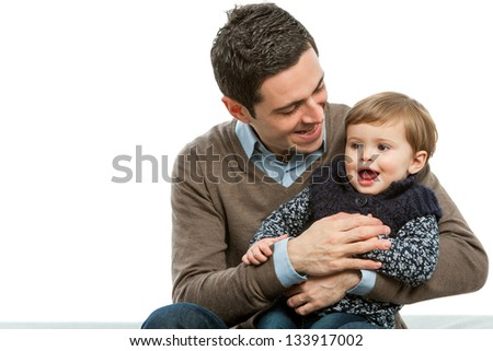 Portrait of young father with his baby daughter.isolated. - stock photo