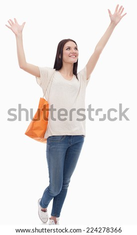Portrait of young female college student with hands up on white background