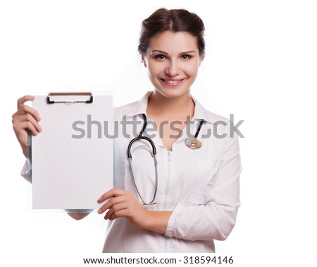 Portrait of young female doctor showing something or copyspase for product or sign text,