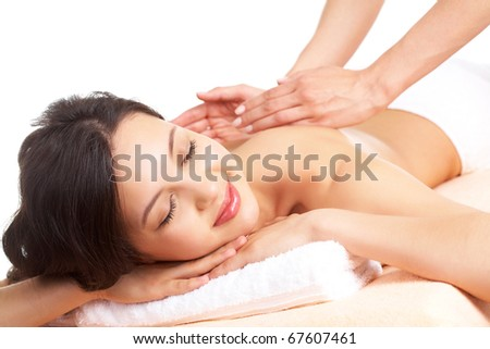 Portrait of young female enjoying the procedure of massage - stock photo