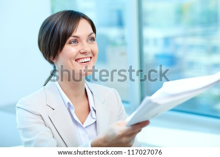 Portrait of young female holding proficiency test - stock photo