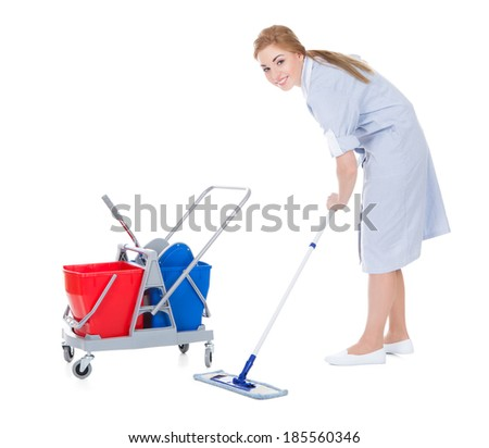Portrait Of Young Female Maid Cleaning Floor With Mop - stock photo