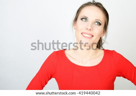 Portrait of young female model. Kind girl with smiling face. Model wearing red dress.