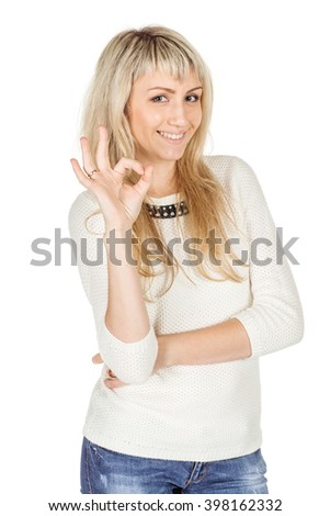 Portrait of young female student gesturing OK sign and smiling. human emotion expression and lifestyle concept. image on a white studio background. - stock photo
