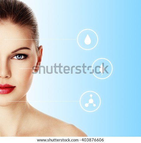 Portrait of young female with healthy skin over blue background with symbols of face moistening, rejuvenation and renew. Facial care concept.  - stock photo