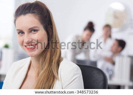 Portrait of young female worker of corporation