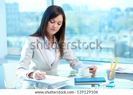 Portrait of young female writing proficiency test - stock photo