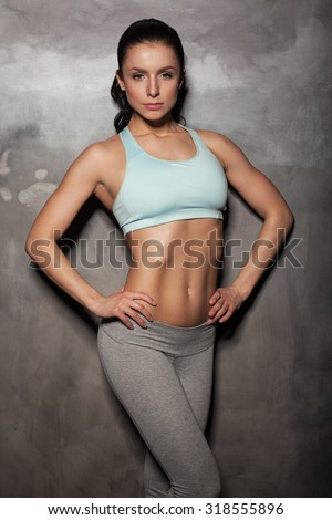 portrait of young fitness woman, with beautiful abdominal - stock photo
