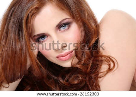 Portrait of young fresh beautiful girl with gorgeous red hair