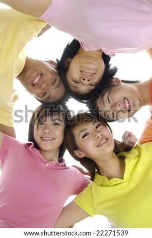 Portrait of young friends arm in arm enjoying together