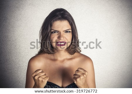 Portrait of young furious woman - stock photo