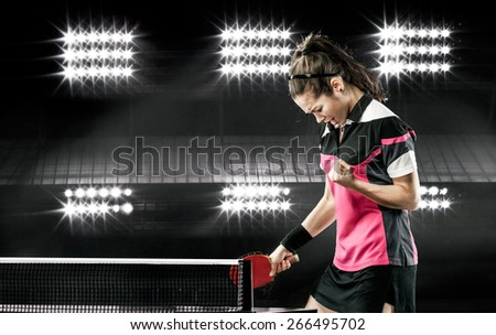 Portrait Of Young Girl Celebrating Flawless Victory in Table Tennis On Dark Background with lights - stock photo
