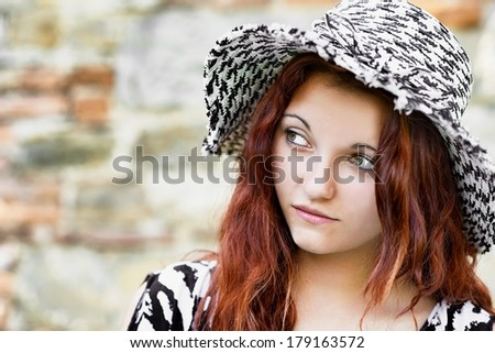 Portrait of young girl in a hat
