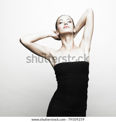 Portrait of young girl in black dress - stock photo