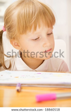 Portrait of young girl looking at copybook at home - stock photo