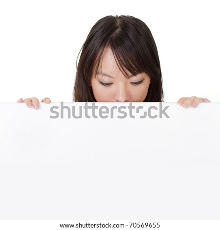Portrait of young girl looking down on a white blank board. - stock photo