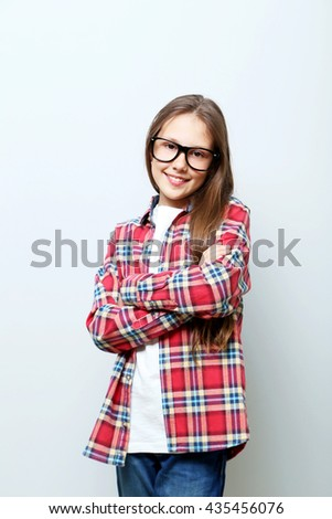 Portrait of young girl on grey background - stock photo