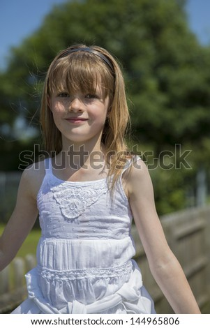 Portrait Of Young Girl On Sunny Day Wearing White lace Top