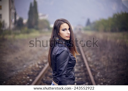 Portrait of young girl outdoors thinking