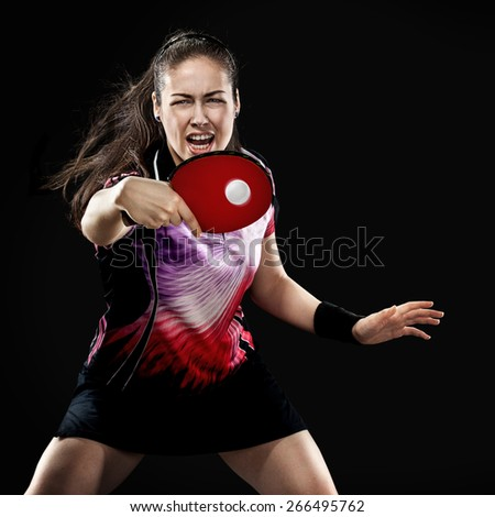 Portrait Of Young Girl Playing Tennis On Black Background  - stock photo
