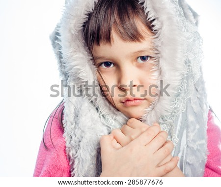 Portrait of young girl, with furry hood - stock photo