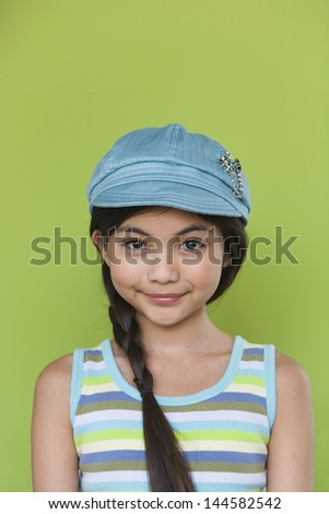 Portrait of young girl with hat