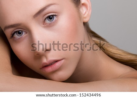 Portrait of young girl with natural, beautiful lips and eyes. Studio shot on neutral background. - stock photo