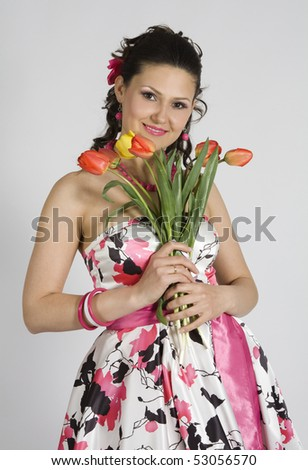 Portrait of young girl  with tulips - stock photo