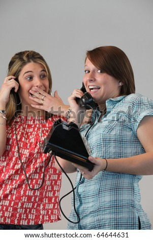 Portrait of young girls on phone - stock photo