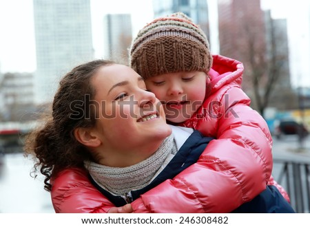 Portrait of young girls together in the city - stock photo