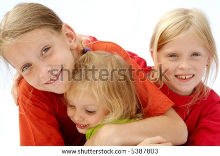 Portrait of young girls wearing red t-shirts - stock photo