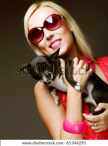portrait of young glamorous woman with toy-terrier - stock photo