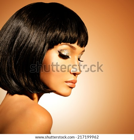 Portrait of young glamour woman  with shot hairstyle  over colored background - stock photo