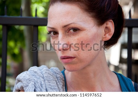 portrait of young gloomy woman - stock photo