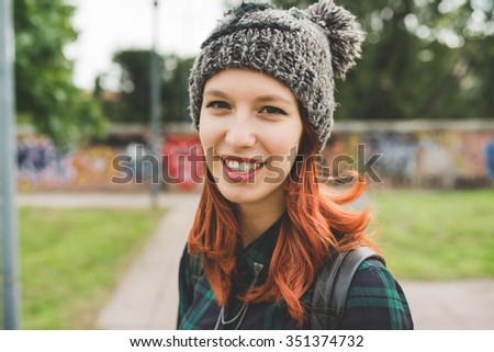 Portrait of young handsome caucasian redhead straight hair woman wearing hat looking in camera smiling - carefree, youth, having fun concept - stock photo