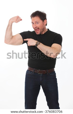 Portrait of young handsome charismatic man in black shirt screaming with hands up - stock photo