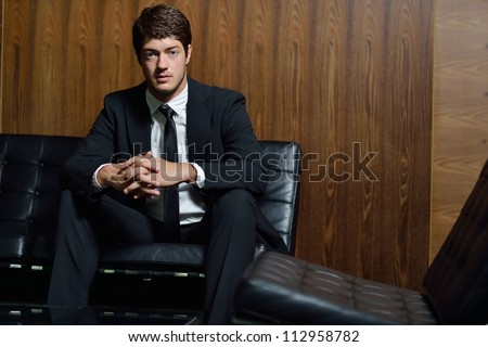 portrait of young handsome happy  business man - stock photo