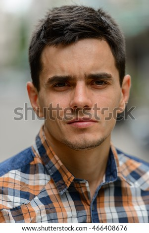 Portrait of young handsome man outdoors