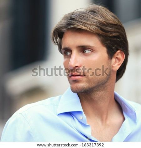 portrait of young handsome man outside - stock photo