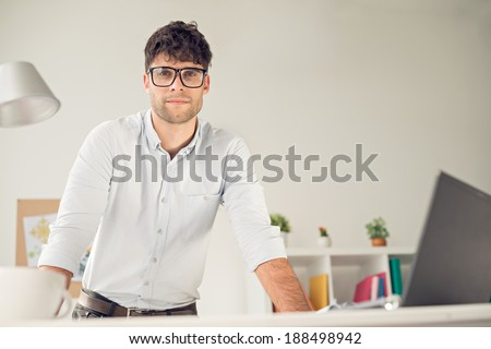 Portrait of young handsome man wearing glasses - stock photo