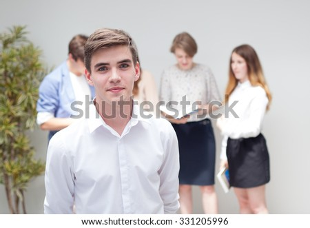 Portrait of young handsome smiling student - stock photo