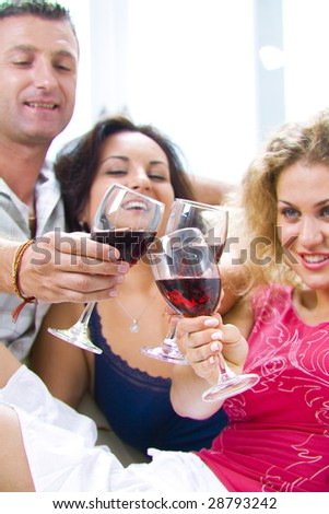 Portrait of young happy attractive people having some wine - stock photo