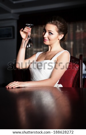 Portrait of young happy beautiful woman in restaurant.  - stock photo